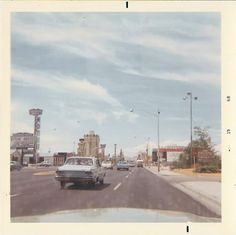 "Las Vegas Strip, 1968. ""Photos taken through the windows of a 1963 Ford Fairlane 500 on our first pass up and down the strip that July."" – Andy"
