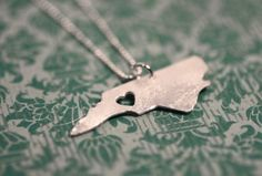 I love _____ necklace.  cute idea- they have one for every state :)  I picked just one of my faves-NC.