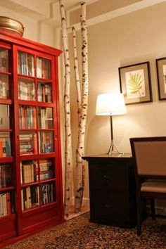 Birch Trees with Red Bookshelf -- you can prop a few birch trees in a corner and call it a day. I have also seen thin birch branches made into curtain rods and you could always chop up a basket of birch trees for firewood, although I'm not sure if it burns well, it would look amazing!