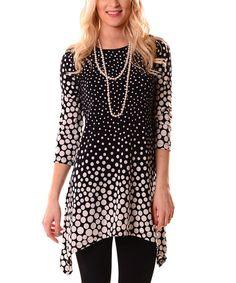 Look at this #zulilyfind! Black & Ivory Polka Dot Sidetail Tunic #zulilyfinds