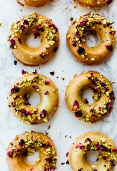 These baked citrus donuts are full of mediterranean inspired flavors that complement each other so well to create the perfect mix of zest and sweetness.