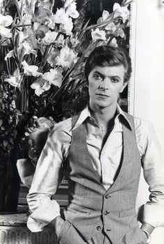 David Bowie looking all sassy with flowers.