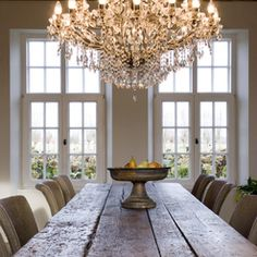 Dining room - love the contrast between the rustic farm table and the chandelier