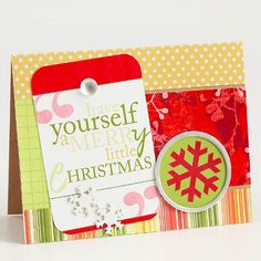 Use paper scraps and your computer for a fun, hybrid background. Print a holiday message and a snowflake dingbat onto photo paper, securing them to folded cardstock with pretty brads./