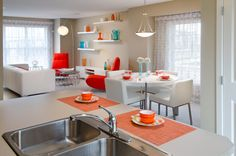 Octic Showhome - Main floor with modern furniture and bright pops of red, orange and blue Morrison Homes, Luxury Estate, Home Builders, Modern Furniture, Small Spaces, New Homes, Vibrant, Design Inspiration, Bright