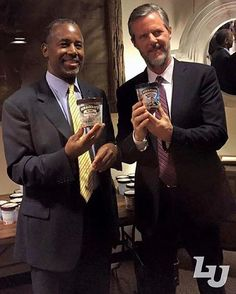 Dr. Ben Carson and President Jerry Falwell pose for a picture with Ben and Jerry's at the Ice Cream Social.