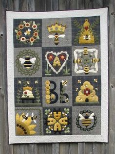 Blessed Bee is a charming quilt featuring hand-dyed wool applique on light and dark gray flannel back Motifs Applique Laine, Wool Applique Quilts, Wool Applique Patterns, Wool Quilts, Felt Applique, Mini Quilts, Quilt Patterns, Appliqué Quilts, Wool Embroidery