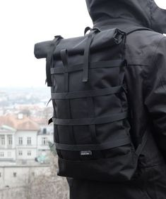 Rolltop black backpack for urban cycling, daily commuting and travels Cordura rolltop backpack with webbing for bulky cargo. 55 x 31 x 9 cm outer zipper pocket. Rucksack Backpack, Black Backpack, Messenger Bag, Photo Backpack, Look Fashion, Fashion Bags, Mens Fashion, Mochila Formal, Roll Top