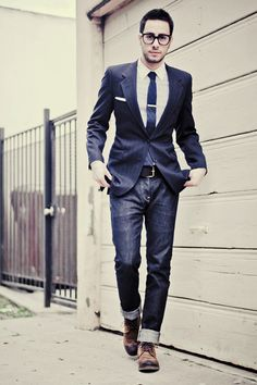 He's got on his jeans and tie.