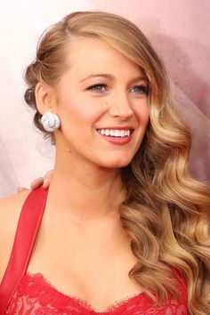 To recreate Blake's look: Use a large curling iron to create the large waves and pin one side back in three sections.