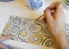 monoprints on clay pottery . . .  Hey Lisa L.  This would be a perfect lesson for your high school students.  ...it is super easy to make colored slips.