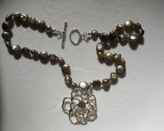 Green pearl necklace with silver floral by LoveHAIGHTDesigns, $38.00