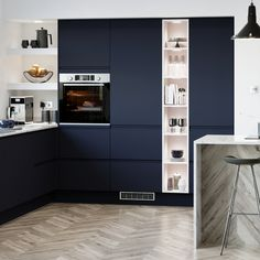 Maximise space, and display a touch of your personal style, by asking your builder to create a bespoke tower shelving storage unit for your kitchen. Navy Kitchen, Open Plan Kitchen Living Room, Kitchen Dining Living, Home Decor Kitchen, Kitchen Furniture, Kitchen Interior, Furniture Stores, Kitchen Shelving Units, Kitchen Units