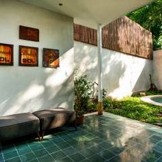 Casa del Arbol: Terrazas de estilo translation missing: mx.style.terrazas.moderno por Taller Estilo Arquitectura