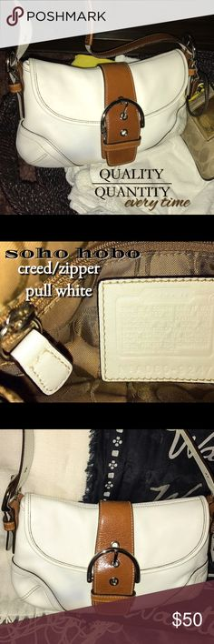 Authentic Coach Soho Buckle Flap Hobo Absolutely gorgeous Medium Soho Hobo from COACH! Only one spot on the strap and I'm actively working on it..lol but she looks soooo good compared to when I saw her first!!! White leather with brown accents like the Buckle and a part of the strap. Classic signature c inside print with white creed and zipper pull. I'll grab the measurements asap. 😉 Coach Bags Hobos