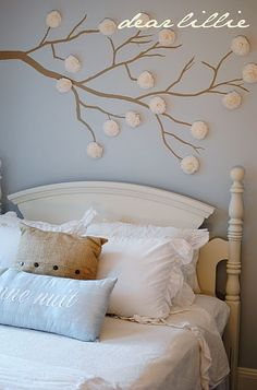 "wall decor: I love the shade of blue and creams.  Love the branches with the crape paper flowers on the wall. And of course I love the ""good night"" pillow. :)"