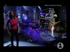 """Mike Oldfield with his 1999 tour band performing """"Moonlight Shadow"""" live in VH1 studio."""