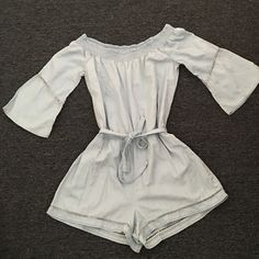 American Rag romper New without tags, never worn....light denim material....can be worn off the shoulder or on....small lipstick stain toward upper back...should be removable when cleaned. American Rag Dresses