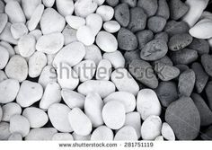 Background of black and white pebbles. Toned.