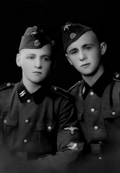 A portrait of two conscripts of the Latvian Legion (Latvian: Latviešu leģions). The Latvian Legion was a formation of the Waffen-SS created in 1943. Mostconscripts of the Latvian Legiondid notadhere to or follow National Socialist ideology. They were intent on thwarting the annexation and occupation of Latvia by the Soviet Union.