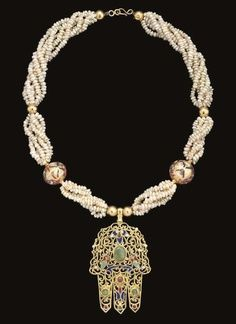 Moroccan Gemset Gold 'Hand of Fatima' Necklace | Fez | 19th Century. | The pendant worked with bevelled scrolling openwork gold enclosing inset stones and also panels of coloured enamels, the reverse plain, suspended on multiple seed-pearl strands with enamelled gold spherical bead and smaller plain gold bead spacers