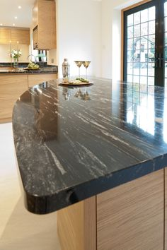 The granite used on this kitchen island is Virginia Mist, sometimes called Sea Wave which describes the free flowing nature of this remarkable stone. There are sporadic flecks of gold in the granite, which causes lots of excitement when found! Grey Countertops, Granite, Sea Waves, Virginia, Kitchen Ideas, Kitchen Island, Boston, Dining Table, Contemporary