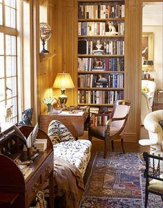 A Masculine Library  Designed by Albert Hadley, this New York City apartment office features a custom bench with corner arms, which is upholstered in Tiger silk velvet in Oro by Lee Jofa. The desk chair is covered in Liberty's Papageno from Osborne & Little. The Stark rug is made of vintage carpet fragments. Italian marbleized paper lines the bookcase.