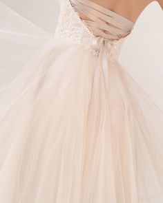 All tied up in floral lace & dreamy tulle (Link in bio to shop the Rowland Gown)