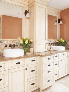 Middle lower cabinetPersonalized Storage        In this master bathroom, customized cabinetry and a linen closet ensure a plethora of storage opportunities. The spacious dual vanity -- treated with an antique finish -- offers double the storage space. Customized cabinet and drawer inserts keep all grooming and bathing supplies stored out of sight.