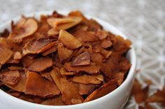 Coconut Bacon. Healthy vegan alternative to bacon. Coconut flakes, liquid smoke, soy sauce, ground pepper and maple syrup.