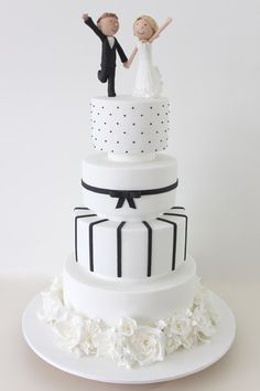 Black and White with Dancing Figurines - One of my favourite cakes of all time, the the bunch of roses at the bottom of the cake was made to match the ruffles on the bride's dress.