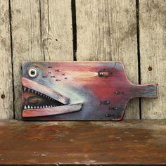 Ryba+Dekorace+je+vyrobena+ze+starého+kuchyňského+prkénka.+Je+doplněna+různými+kusy+dřeva.+Dekorace+je+barevně+patinovaná,+malovaná+a+ošetřena+voskem+na+nábytek.+Rozměry:+26x+12+cm