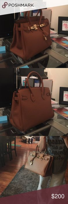 Brown Tote Bag Brand new. Comes with all tags and packaging. Dust bag. Even comes with handle covers. 30cm Bags Totes