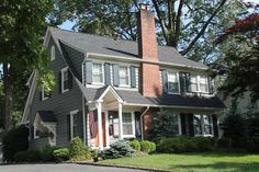 Best exterior colors for colonial revival houses dark gray blue cottage :  Shown: Amherst Gray (body); Navajo White (trim); Soot (shutters), from Benjamin Moore. Rust (door) by Benjamin Moore, custom mixed in Hollandlac Brilliant by Fine Paints of Europe.