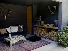 Love the way they have used the reindeer hide over the foot stool. Outdoor Rooms, Outdoor Gardens, Outdoor Living, Eclectic Furniture, Pergola, Outside Living, Winter Porch, Cozy Place, Modern Landscaping