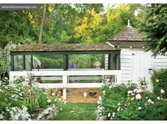 This chicken coop is so elegant.  The landscaping is beautiful.  I love the grass path to the coop.