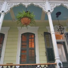 New Orleans Front Porch. Notice the haint blue paint on the ceiling.