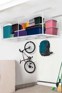 Take advantage of ceiling space by mounting a heavy duty overhead shelf like this one from Amazon.