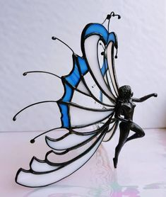 Stained glass fairy, angel in Tiffany, glass sculpture of fairy, with glass wings or angel wings and a tin body, beautiful glass figurine Broken Glass Art, Sea Glass Art, Shattered Glass, Tiffany Stained Glass, Tiffany Glass, Stained Glass Crafts, Stained Glass Patterns, Terrasse Design, Glass Art Design