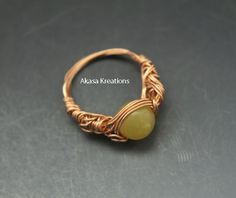 ‪#‎HEPTEAM‬  Brass wire wrapped Jade ring, US size 6. Made from a Jade bead and 26 gauge brass wire. Intricate wrapping.