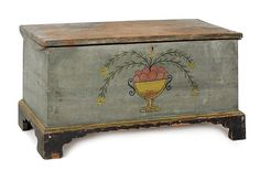 Delaware painted hard pine diminutive blanket chest, circa 1810, retaining its original urn of fruit decorated on a Prussian blue blackground, 18 H. x 36 W.