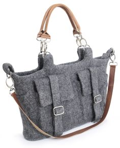 Felt Bag. 100% Wool (except leather handles and metal parts). Handmade in Ala Kiyiz technique (solid rolled, no stitches). Colors: light grey; grey; dark grey. Dimensions: 38х28х11 cm. Felt's amazing property is its elasticity that allows you to create a wide variety of texture of the product. Felt is unique for its soundness and durability, at the same time being warm, soft and cozy.