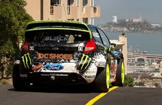 Gymkhana five by ken block  american professional rally driver and co-founder of DC shoes ken block has released the newest addition of his gymkhana video series.  using a modified 2012 ford fiesta rally car, the streets throughout the entire san francisco bay area are transformed into a gymkhana course:  a track where drivers navigate a series of drifts and stunts through pre-determined obstacles.