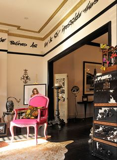 the perfect girly accent: hot pink armchair, King Louis XIV style no less.