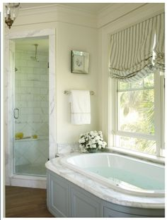 Love the corner shower with glass door only. The marble is pretty but not really my style