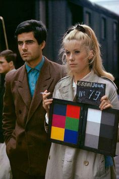 Catherine Deneuve and Nino Castelnuovo on set of The Umbrellas of Cherbourg/ Les Paralpluies de Cherbourg (1964)
