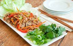 Pork Stir-Fry Lettuce Wraps // Try this Chinese pork and veggie stir-fry spooned onto crisp lettuce leaves and topped with fresh cilantro and green onions. Load it up with your favorite veggies and enjoy for a delicious dinner!