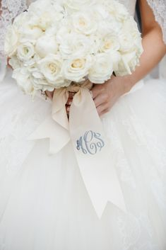 The southern way to do a bridal bouquet! Love this ivory ribbon embellished with a dusty blue monogram. // Meghan + Ryan: Multi-Cultural Wedding at Perkins Chapel and The Ritz-Carlton | DFW Events | Photo: Stephen Karlisch