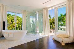 Minimalist bathroom with bathtub and shower cabin