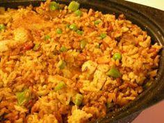 Jollof w/ Chicken:-West African delicacy.